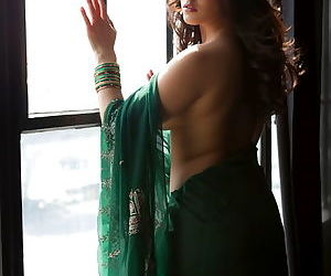 Indian garb is hot on stripping pornstar Sunny Leone in solo tease