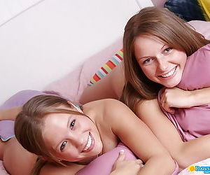 Very young teen babes getting naughty in bed