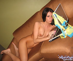 Yellow-and-blue G-strings concealing an outstandingly yummy teen pussy
