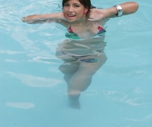 Adolescent Mexican chick location in the pool in a miniature revealing bikini