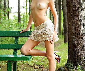 Naked and super hot blonde in the forest shows her shaved tight pussy