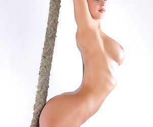 Ballerina gets naked and shows us her big tits and her shaved pussy