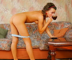 Foxy teen babe drinking coffee and showing off pussy