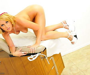 The naughty nurse has a shaved pussy and perky tits to show off