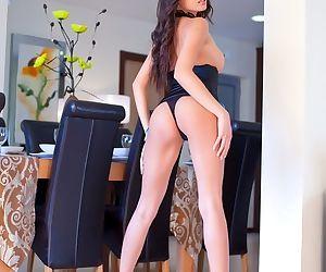 Asian Davon Kim in tight black corset models her perky fake tits