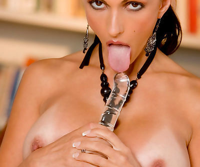 Brunette with huge tits enjoys large glass toy during dirty solo session
