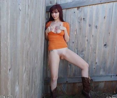Ivy Snow as a redhead is truly irresistible in the outdoors tease