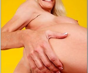 She masturbates her pussy and he shows up to fuck the milf hard