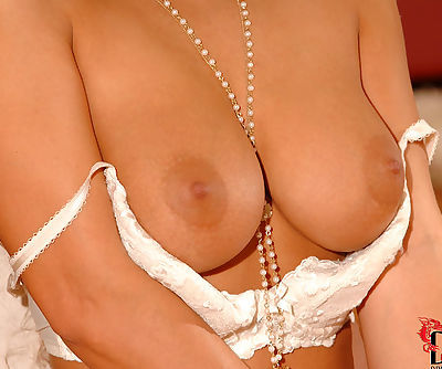 Curly redhead Dorothy Black has massive knockers and lascivious pussy and she sticks it so cool