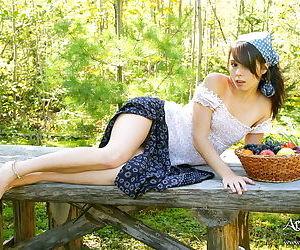 Undernourished teen broad dressed as village newborn