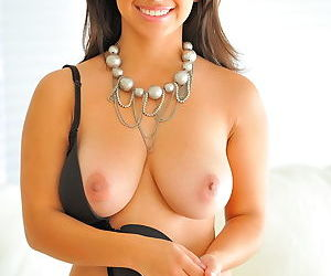 Fresh young pussy and a great smile go well with her big natural tits