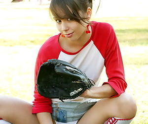 Very hot and sexy subfusc teen plays baseball nearby slutty outfit