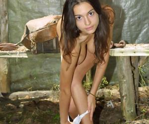 Big breasted teen hottie exposing her horrific coils