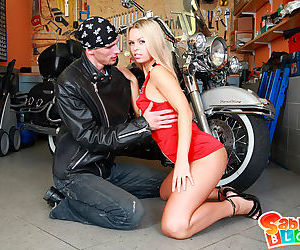 Young biker bangs an adorable blondie in garage making her pussy gape