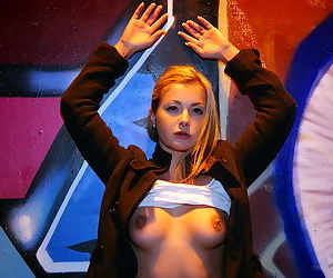 Girl in very little clothing shows off her boobs and her hot pussy