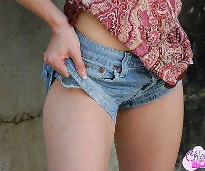 She poses outdoors and she teases a little bit of very sexy flesh