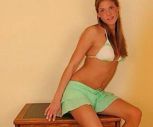 Teen in a bikini strips so you can see her sexy titties