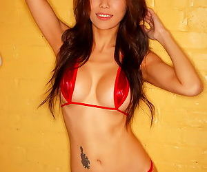 Asian with really nice perky tits is modeling and hoping to turn you on