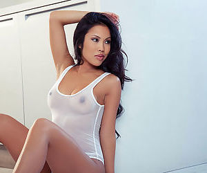 Insolent asian Thuy Li likes to pose her big tits and puffy cunt in solo