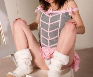 Dark hair infant hottie teasing in smoking lewd pink suit