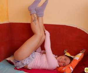Cute teen gal in Lilliputian unspecified posing seductively