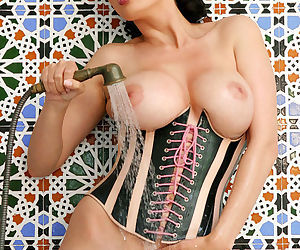In a tight leather corset pornstar Tera Patrick takes a warm wet shower