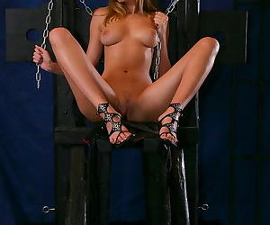She poses with chains and shows her fully nude body, including a pussy