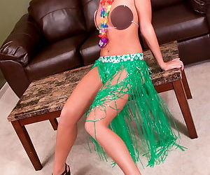 The brunette in the cute Hula outfit is removing everything to show pussy