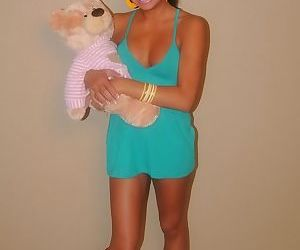 Cutie posing with her teddy bear and licking a lolli