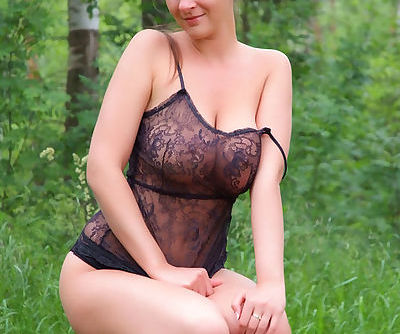 The black lace lingerie that clings to her big natural tits is mouth watering