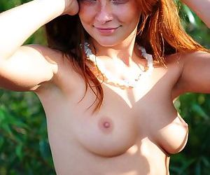 Red hair and a shaved pussy that looks so tight make Indiana Belle sexy