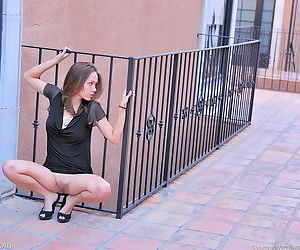 Girl in a black dress toys her pussy deep and wonderfully in public