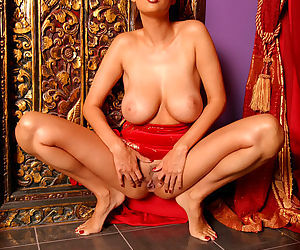 Big tits Asian Tera Patrick brings a red dildo to fuck her sexy pussy