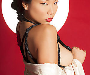 Elegant Asian stunner looks overwhelming in her weird lingerie, and she hypnotizes with her eyes