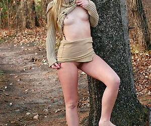 Girl outdoors in a tasty turtleneck sweater teasing with her pussy
