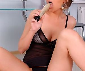 Lovely brunette girl in lingerie has a toy that wants to be in her pussy