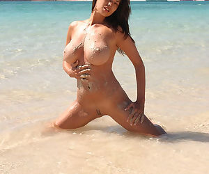 Busty Tera Patrick gets all wet and sexy on the beach