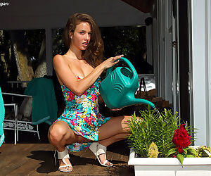 Malena Morgan brings us outdoors in her solo pics and shows her hot pussy