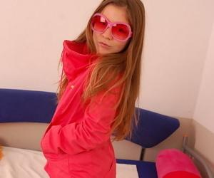 Long haired blonde teen posing regarding pink