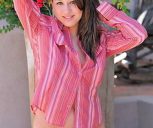 Pretty brunette with a great smile shows off her incredible shaved pussy