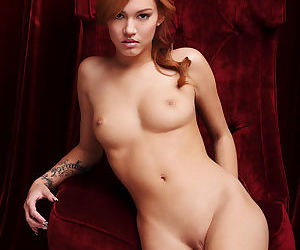 Young beauty shows her perfect body with small tits and a hot shaved pussy