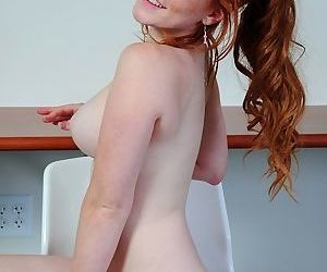 Natural redhead sticks a sex toy into her neatly trimmed pink flower