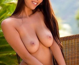 Asian Sharon Lee has natural breasts and outdoors she shows them erotically