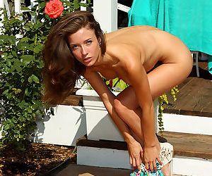 Young lady in a floral dress has a breathtaking body with a sexy shaved cunt