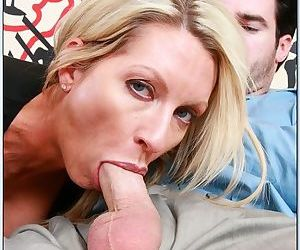 Hot blonde milf with shaved cunt sits on his boner and rides him