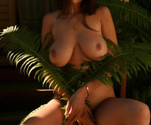 Spectacular young lady posing utterly in nature\'s garb outdoors