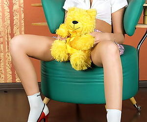 Redhead schoolgirl poses in her skirt and masturbates her pussy with a toy