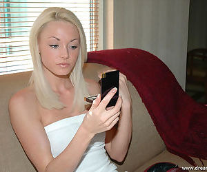 Teen beauty in a white dress puts on makeup and shows her pussy