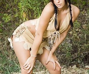 Busty latina babe dressed like an Indian warrior