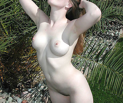 Hot young bimbo stripping outdoors